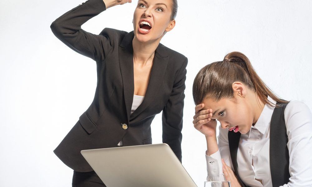 Two corporate professionals pictured. Both visually distressed, the image is intended to set the scene for the topic of this course - difficult conversations and how to have them.