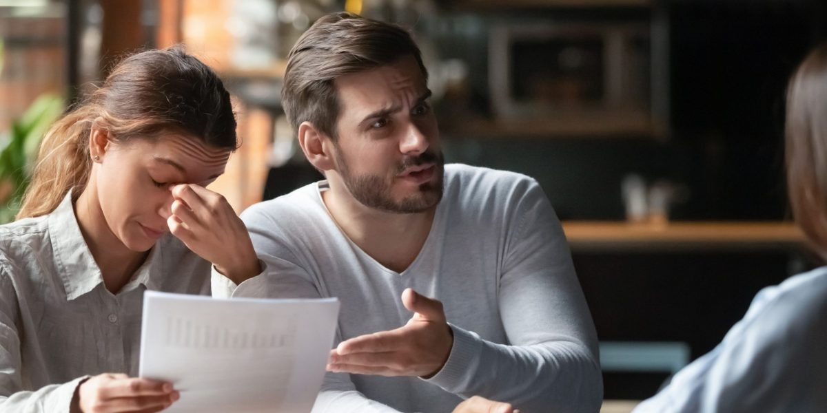 Two corporate professionals visibly arguing and appearing frustrated. The image is intended to set the scene for the customer complaint management / handling course.